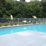 Our crew putting the finishing touches on a pool patio. Farmington CT